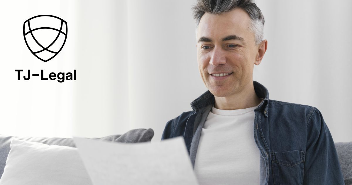 muž čte list se Steuer-ID